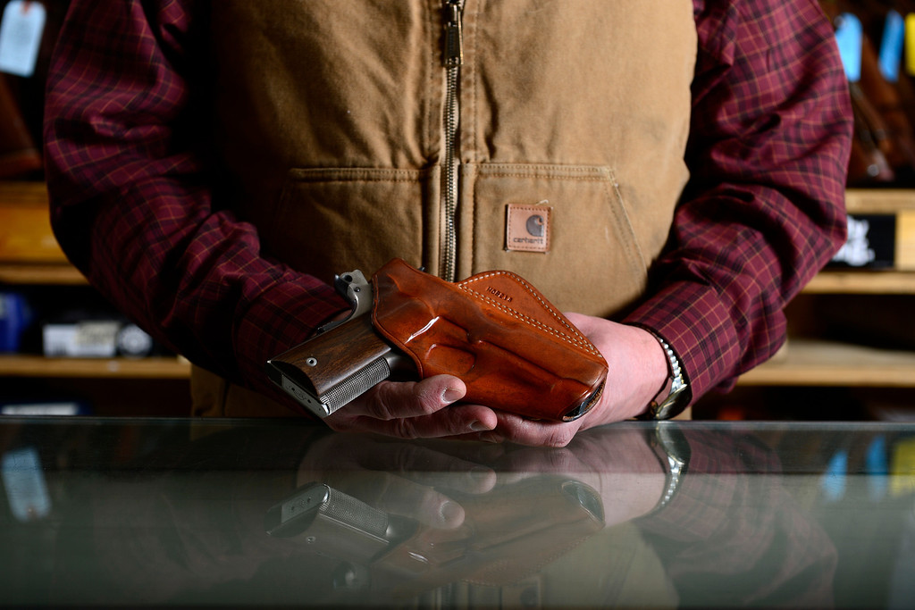 . MONTE VISTA, CO - FEBRUARY 26: Valley Gun owner Carlton Thomas says that he is always carrying a gun -- a Colt 911 officer\'s model in this instance. Gun owners in southern Colorado largely agree that responsible ownership begins at home. (Photo by AAron Ontiveroz/The Denver Post)