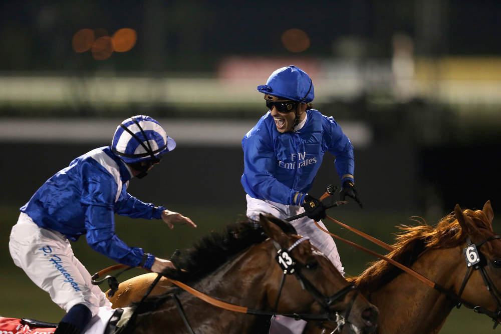 . Silvester De Sousa celebrates riding African Story to victory to win the  Dubai World Cup  at the Meydan Racecourse on March 29, 2014 in Dubai, United Arab Emirates.  (Photo by Francois Nel/Getty Images)