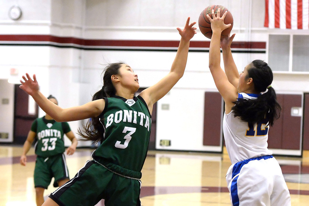 . Bishop Amat\'s Amanda Alvarado (12) rebounds past Bonita\'s Cassie Martinez (3) in the first half of the Covina basketball tournament at Covina High School in Covina, Calif., on Saturday, Dec. 14, 2013. Bonita won 49-41.   (Keith Birmingham Pasadena Star-News)