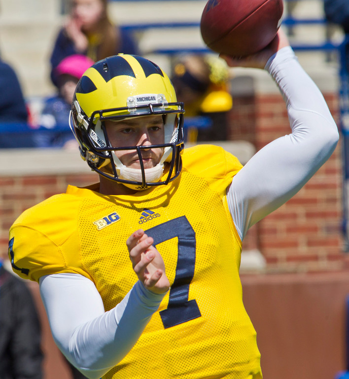 . Michigan quarterback Shane Morris (7) throws passes during the football team\'s annual spring game, Saturday, April 5, 2014, in Ann Arbor, Mich. (AP Photo/Tony Ding)
