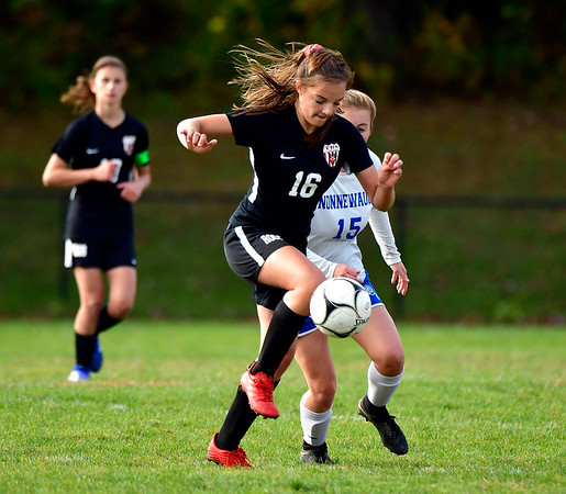 10/10/2019 Mike Orazzi | StaffrTerryville High School's Julianna Lloret (16) and Nonnewaug's Danielle Forte (15) at THS on Thursday.