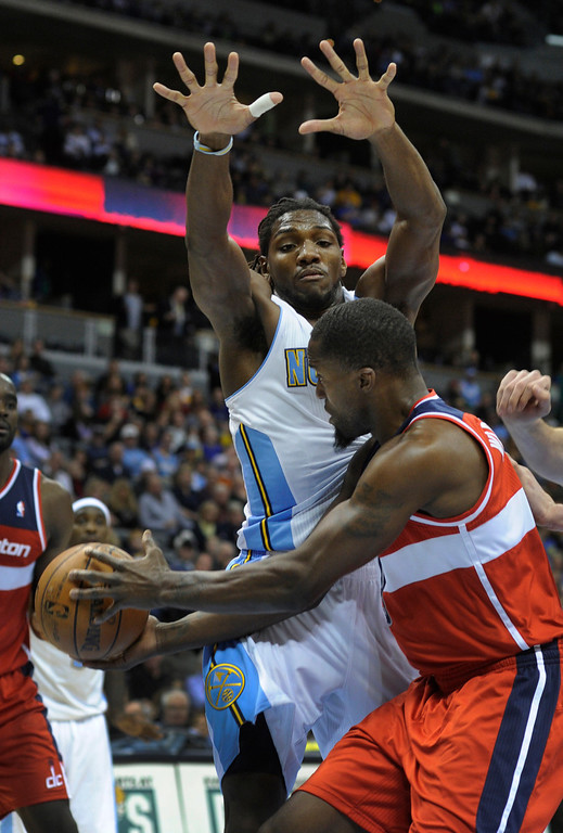 . DENVER, CO - JANUARY 18: Denver forward Kenneth Faried (35) tried to block a shot by Washington forward Trevor Booker (35) in the second half. The Washington Wizards defeated the Denver Nuggets 112-108 at the Pepsi Center Friday night, January 18, 2013. Karl Gehring/The Denver Post