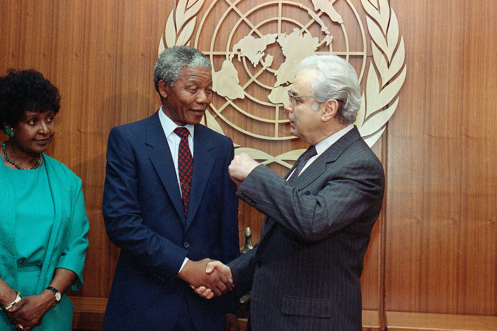 . United Nations Secretary General Javier Perez de Cuellar greets Nelson Mandela at the U.N Friday, June 22, 1990 in New York. (AP Photo/Doug Mills)
