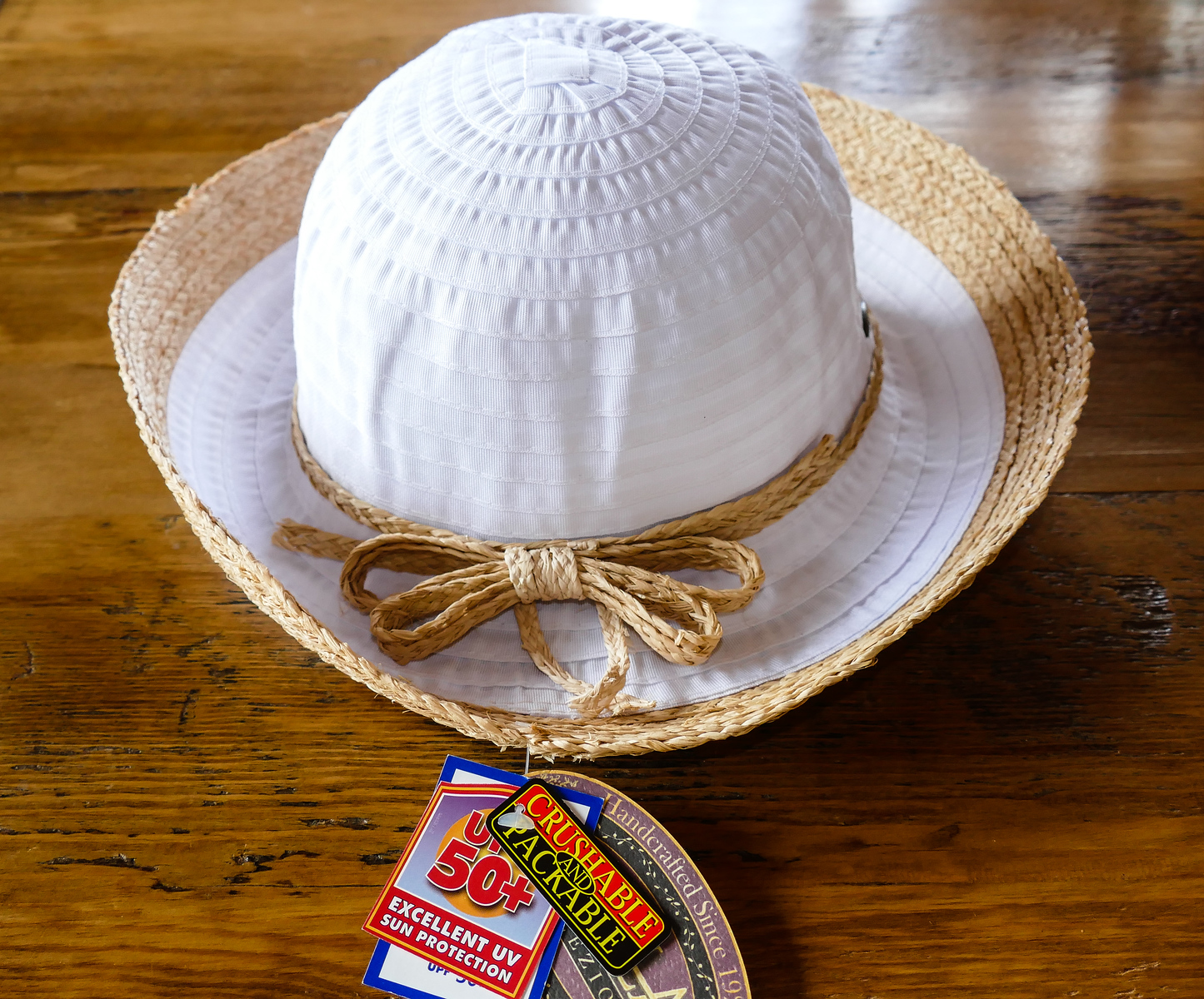 White, packable Scala hat for a trip to Hawaii.