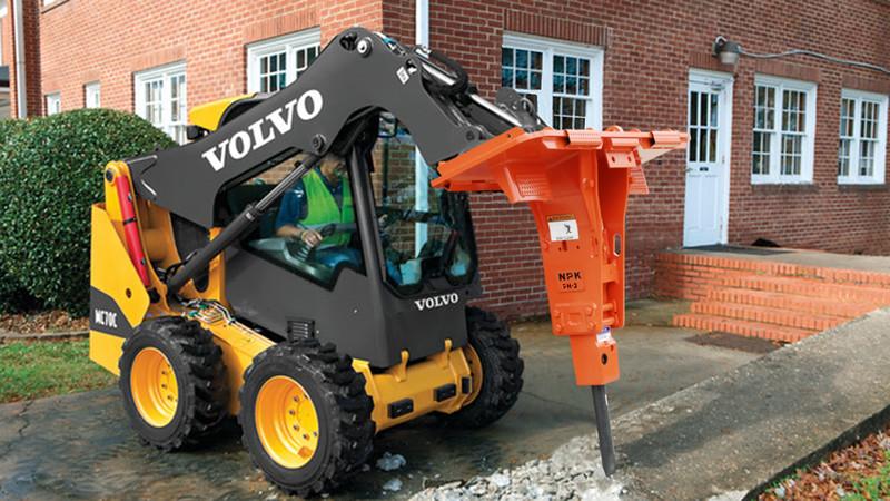 NPK PH3 hydraulic hammer on Volvo Skid Steer repairing sidewalk.jpg