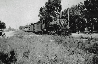 SY - Railroad Engine.  Undated.  This steam engine appears to be returning from a tour -- likely up Spearfish Canyon.