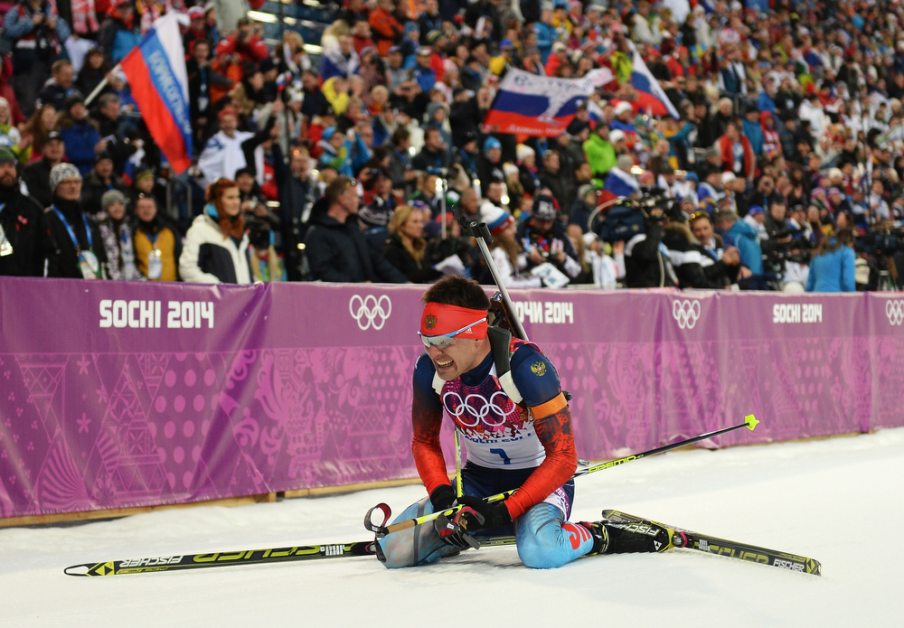 . Evgeniy Garanichev of Russia collapses in the snow after competing the Men\'s Individual 20 km during day six of the Sochi 2014 Winter Olympics at Laura Cross-country Ski & Biathlon Center on February 13, 2014 in Sochi, Russia.  (Photo by Harry How/Getty Images)