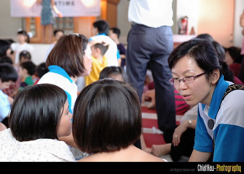 Teacher is getting their student and explaining what will be the next activities for that day.