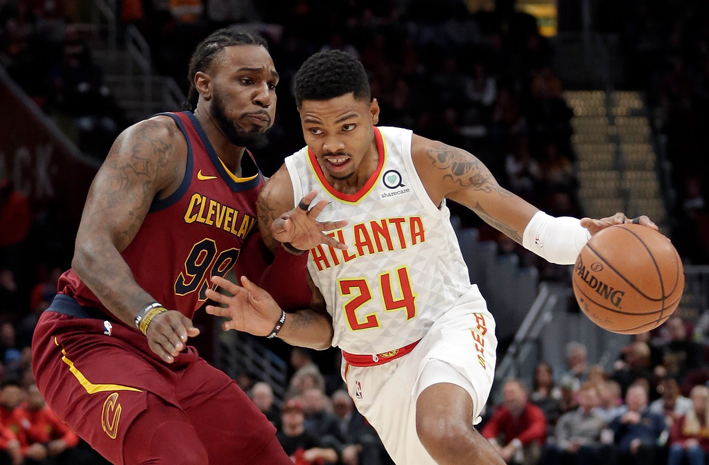 . Atlanta Hawks\' Kent Bazemore (24) drives against Cleveland Cavaliers\' Jae Crowder (99) in the first half of an NBA basketball game, Tuesday, Dec. 12, 2017, in Cleveland. (AP Photo/Tony Dejak)