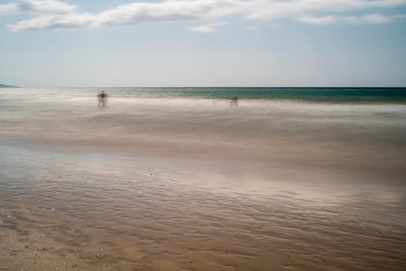 Ghostly people on a beach, long exposure shot, Playa del Carmen, Barbate, Andalusia, Spain.