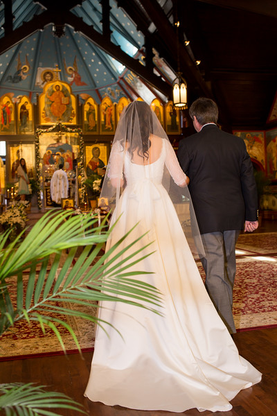 Bride getting walked down the isle before the Orthodox Wedding Ceremony at Christ the Savior Orthodox Church, Chicago.