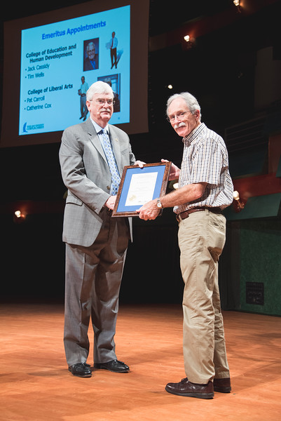 TAMU-CC president Dr. Flavius Killebrew(left) presents Dr. Pat Carroll with the Professor emeritus award, during the 2016 Spring Faculty and Staff Meeting.