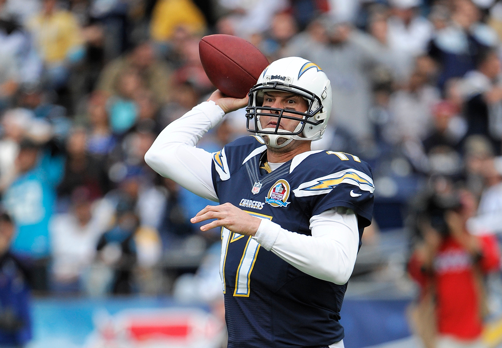 Description of . San Diego Chargers quarterback Philip Rivers aims a pass against the Carolina Panthers during the first half of a NFL football game Sunday, Dec. 16, 2012, in San Diego. (AP Photo/Denis Poroy)