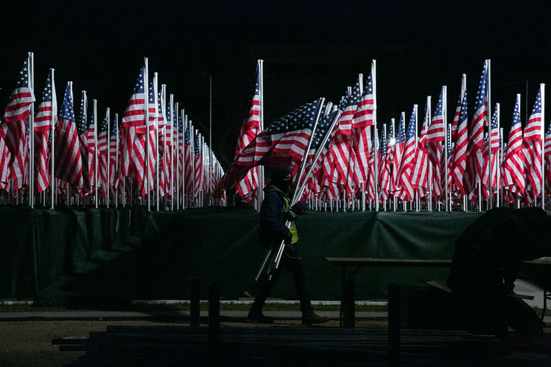 The 'Field of Flags' display is seen on the National Mall on Monday, January 18, 2021. The art display is in lieu of a physical audience for the inauguration this year and includes nearly 200,000 flags representing every state and territory