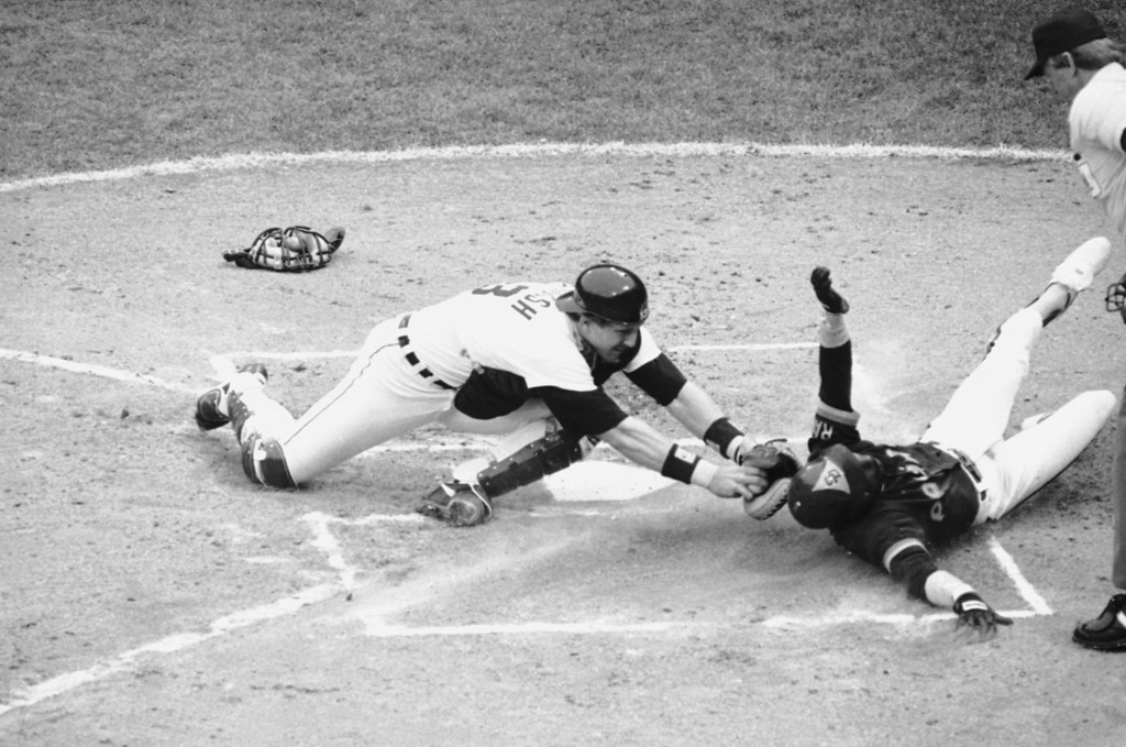 . San Diegos Alan Wiggins, right, slides home in the first inning of World Series game five at Tiger Stadium, Sunday, Oct. 14, 1984, Detroit, Mich. But, hes too late and off the base. Lance Parrish, Detroit catcher, misses the tag as Wiggins slides wide of the plate. (AP Photo/Rob Kozloff)