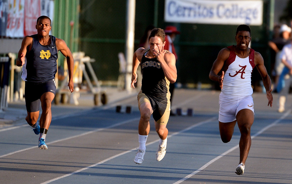 . Notre Dame\'s Trevor Reid, left, St. John Bosco\'s Sean McGrew, center, and Alemany\'s Dominic Davis competes in the 100 meter dash during the CIF-SS Masters Track and Field meet at Falcon Field on the campus of Cerritos College in Norwalk, Calif., on Friday, May 30, 2014.   (Keith Birmingham/Pasadena Star-News)