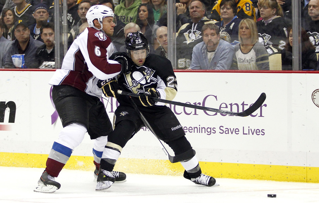 . Chris Conner #23 of the Pittsburgh Penguins handles the puck in front of Erik Johnson #6 of the Colorado Avalanche during the game at Consol Energy Center on October 21, 2013 in Pittsburgh, Pennsylvania.  (Photo by Justin K. Aller/Getty Images)
