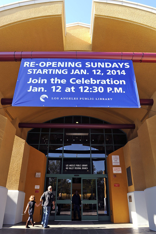 . Starting January 12, 2014 the Los Angeles Public Library�s Central Library and eight regional branch libraries will be open on Sundays from 1 to 5 p.m.  Here, a sign informing visitors hangs outisde the Mid-Valley branch at 16244 Nordhoff St. January 10, 2014 in North Hills, CA.(Andy Holzman/Los Angeles Daily News)