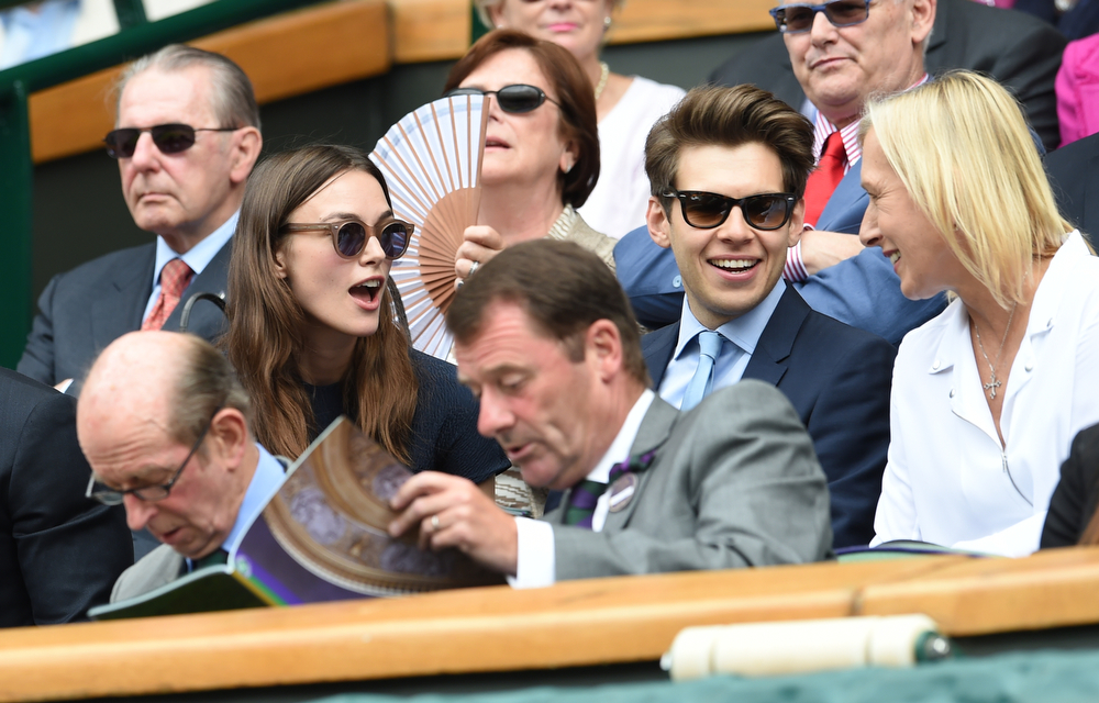 Description of . British actress Keira Knightley and husband British musician James Righton talk to tennis champion Martina Navratilova, right, in the Royal Box on centre court prior to the women's singles final match between Eugenie Bouchard of Canada and Petra Kvitova of Czech Republic at the All England Lawn Tennis Championships in Wimbledon, London, Saturday July 5, 2014. (AP Photo/Andy Rain, Pool)