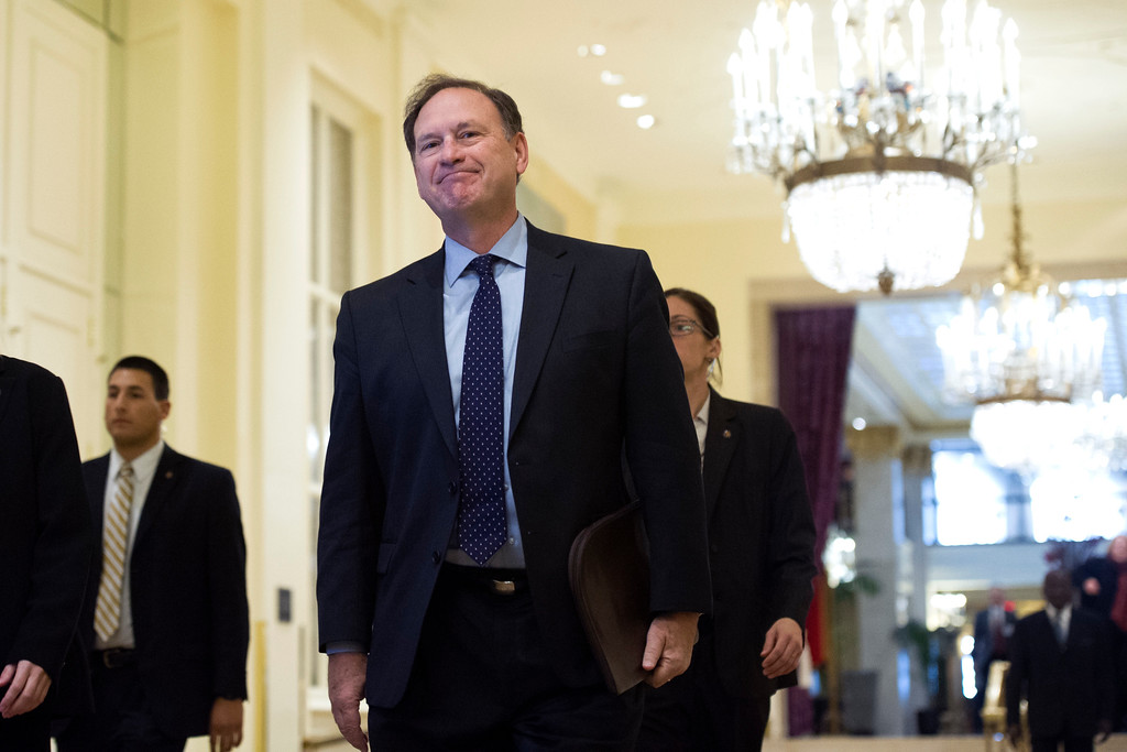 . Supreme Court Justice Samuel Alito arrives at the Mayflower Hotel in Washington, Thursday, Nov. 17, 2016, to address the Federalist Society\'s National Lawyers Convention. (AP Photo/Cliff Owen)