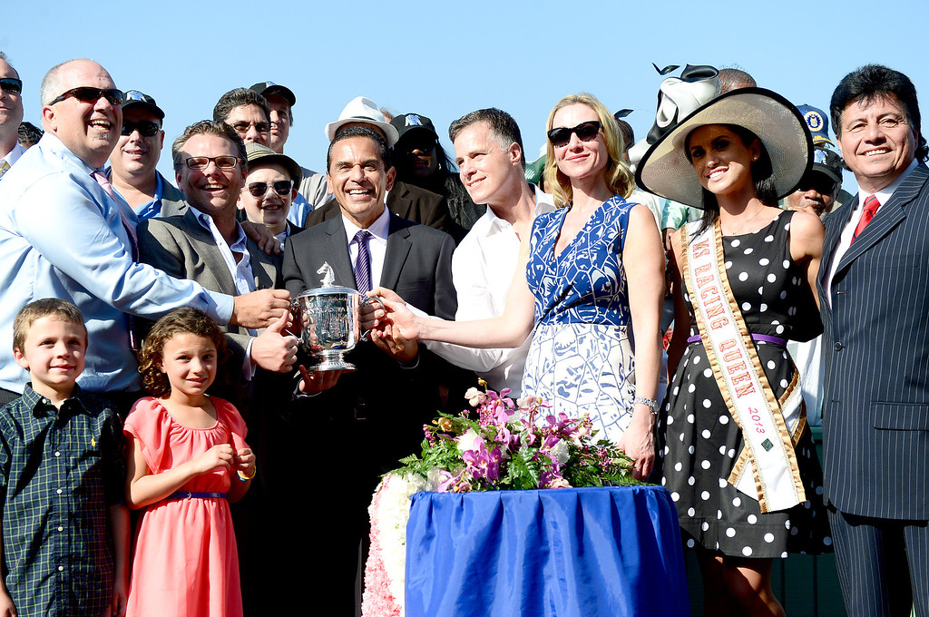 . Los Angeles City Mayor Antonio Villaraigosa hands out the Santa Anita Derby cup after Goldencents win Saturday, April 6, 2013 at Santa Anita Park in Arcadia. Goldencents will now race in the Kentucky Derby. (SGVN/Staff Photo by Sarah Reingewirtz)
