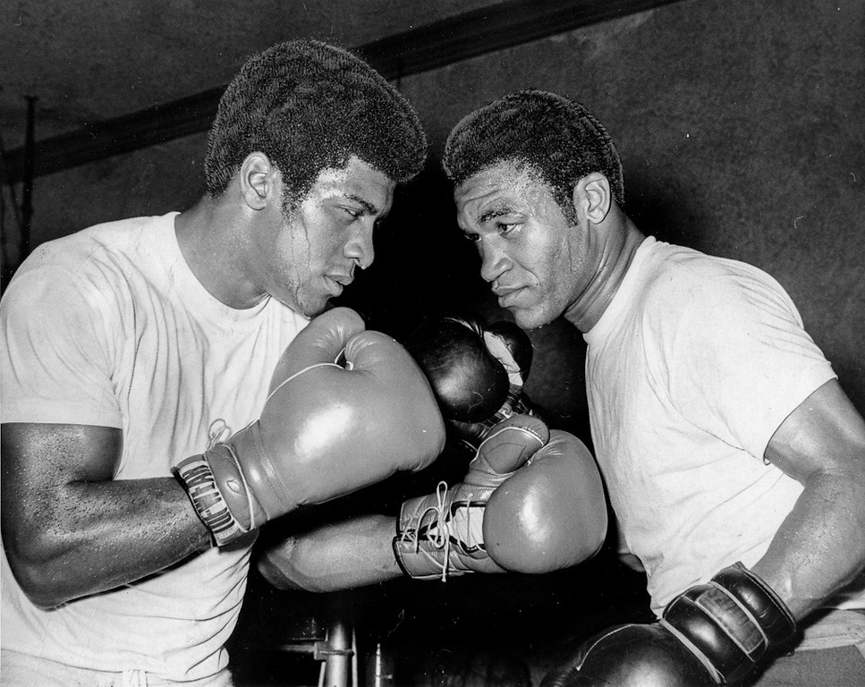 . May 22, 1969 - Ray Anderson (left) squares off with Ralph McCoy before a drill. (Robert Stinnett / Oakland Tribune)