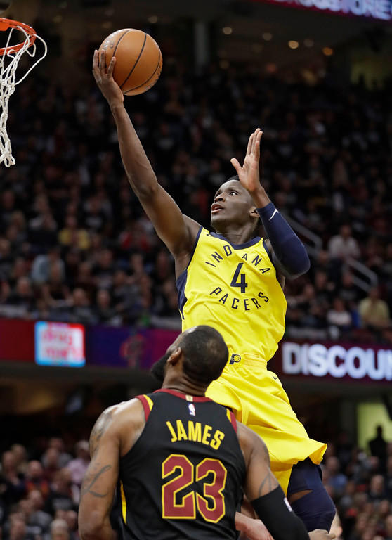 . Indiana Pacers\' Victor Oladipo (4) drives to the basket against Cleveland Cavaliers\' LeBron James (23) in the second half of Game 7 of an NBA basketball first-round playoff series, Sunday, April 29, 2018, in Cleveland. (AP Photo/Tony Dejak)