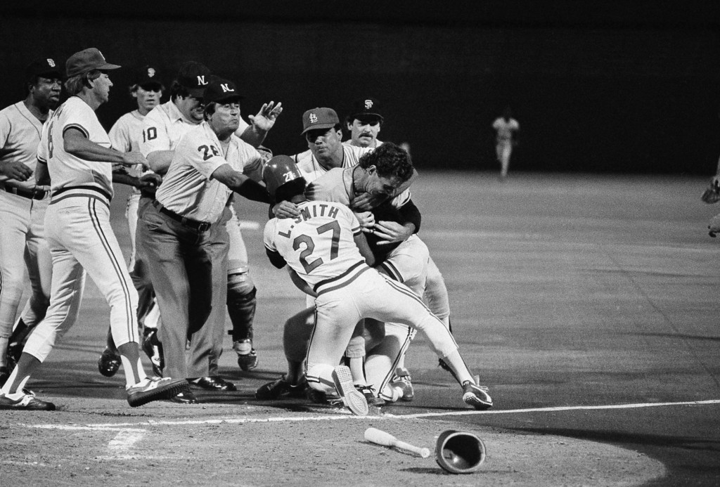 . St. Louis Cardinals\' Lonnie Smith joins members of the San Francisco Giants\' Mike Krukow and the Cardinals\' Joaquin Andujar during a third inning fight, July 18, 1984. Andujar was at bat when Krukow shouted something from the mound directed at him, both players rushed toward each other as the both benches cleared. Several blows were thrown by both Andujar and Krukow but neither was ejected from the game. (AP Photo)