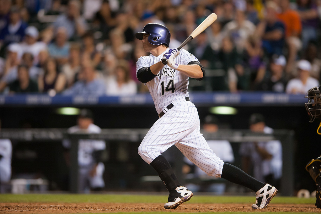 . Josh Rutledge #14 of the Colorado Rockies hits a 2-RBI single in the eighth inning of a game against the Pittsburgh Pirates at Coors Field on July 26, 2014 in Denver, Colorado. (Photo by Dustin Bradford/Getty Images)
