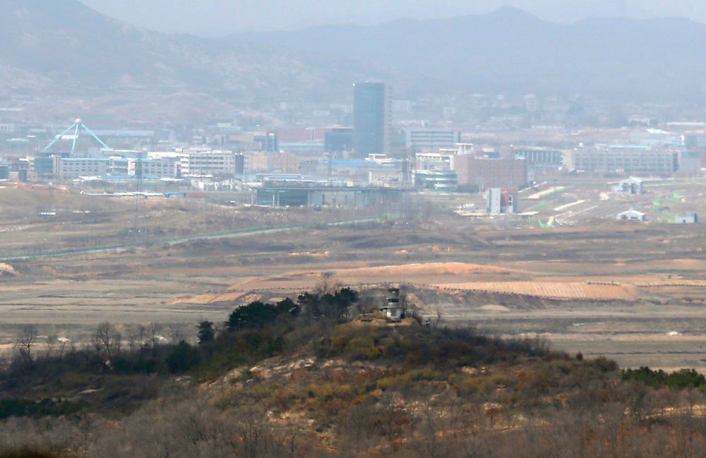 . North Korea\'s Kaesong joint industrial complex is seen over a North Korean guard post (bottom) as seen from a South Korean observation post in the border city of Paju on April 9, 2013.  North Korean workers failed to show on April 9 at the Kaesong joint industrial zone, a day after Pyongyang said it was withdrawing labour and suspending operations at the Seoul-funded complex.   WON DAE-YEON/AFP/Getty Images