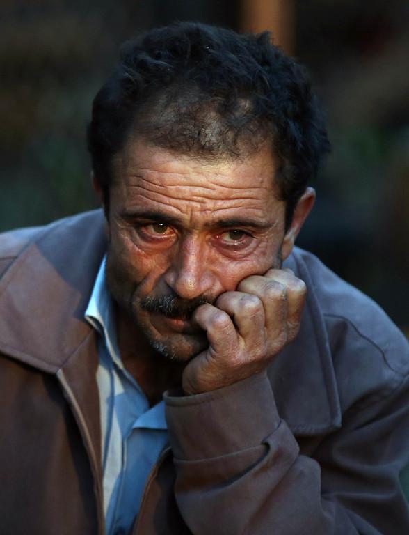 . A family member waits outside the mine in Soma, western Turkey, Wednesday, May 14, 2014. (AP Photo/Emrah Gurel)