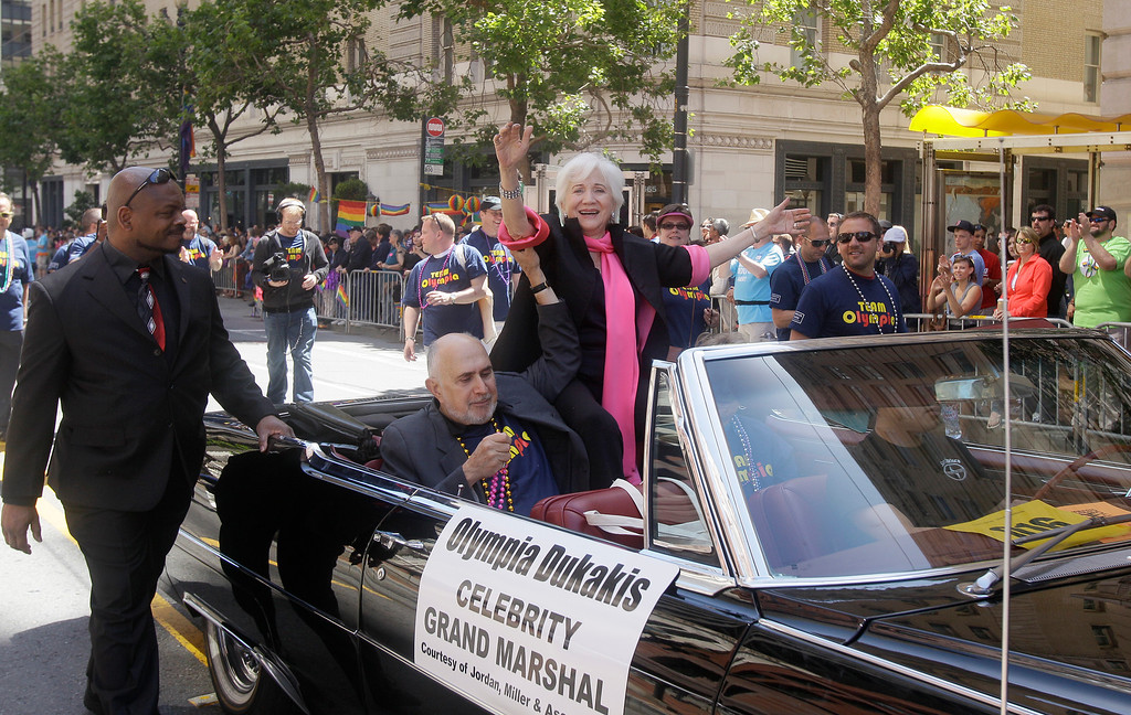 . Actress Olympia Dukakis, a celebrity Grand Marshall for the 41st annual Gay Pride parade, waves to the crowd while being driven past them in San Francisco, Sunday, June 26, 2011. (AP Photo/Jeff Chiu)
