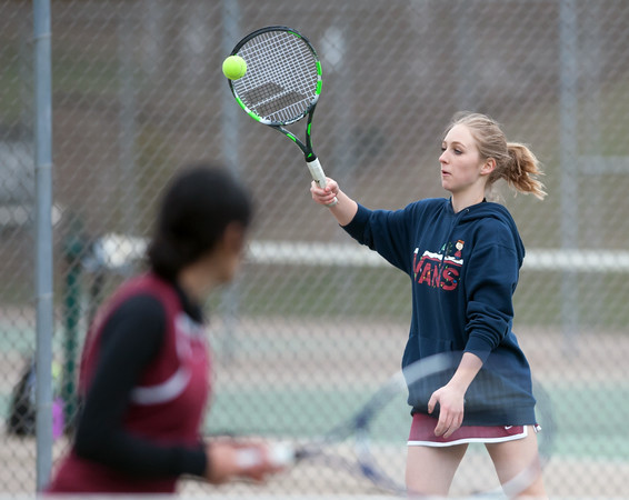 04/17/18 Wesley Bunnell | Staff Berlin girls tennis at New Britain on Tuesday afternoon. Playing doubles was Zoe Hayres, R, and Danya Alboslani.