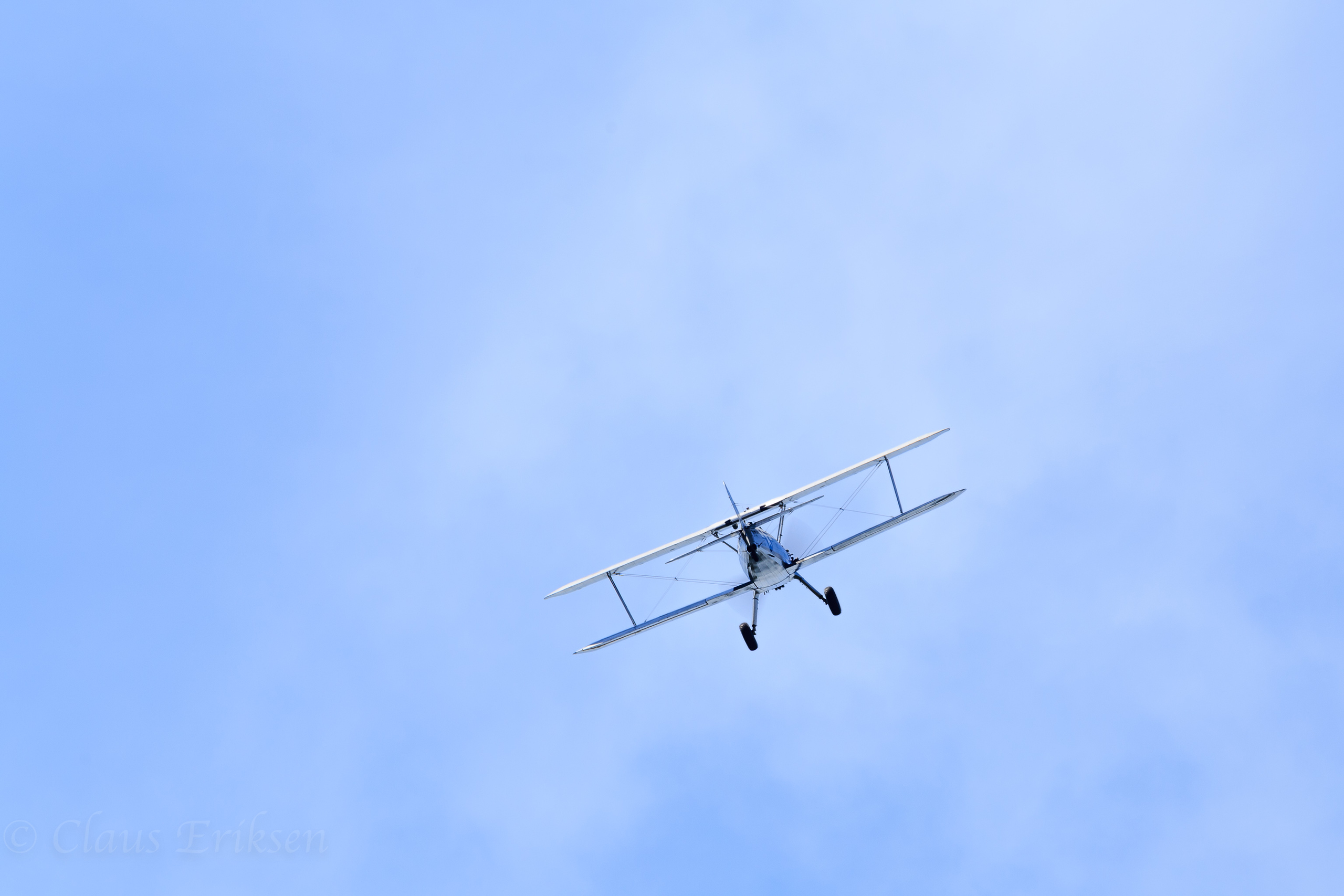 Stearman flying away