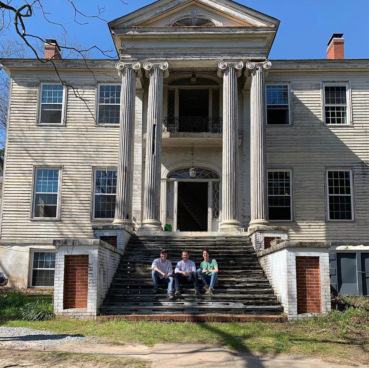 (Left to right) Ross Sheppard, Jacob Hawkins and Will Walker at the pre-renovated c. 1838 Samuel Rockwell House in Milledgeville.