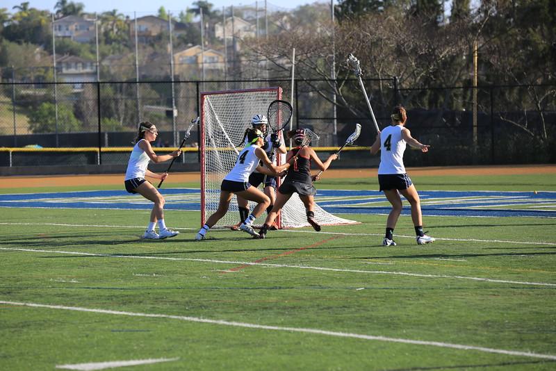 2015_03_31 Girls Lacrosse LCC 15 vs Santa Ana Mater Dei 11 0043.JPG