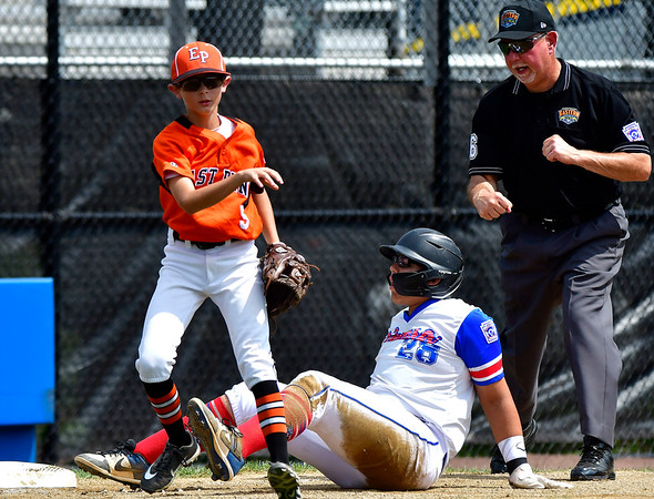 8/7/2019 Mike Orazzi | Staff Pennsylvania's Brody Rafferty (5) doubles up New York's Yady Mateo (28) slides into second during Wednesday's Eastern Regional Little League Baseball game at Breen Field in Bristol.