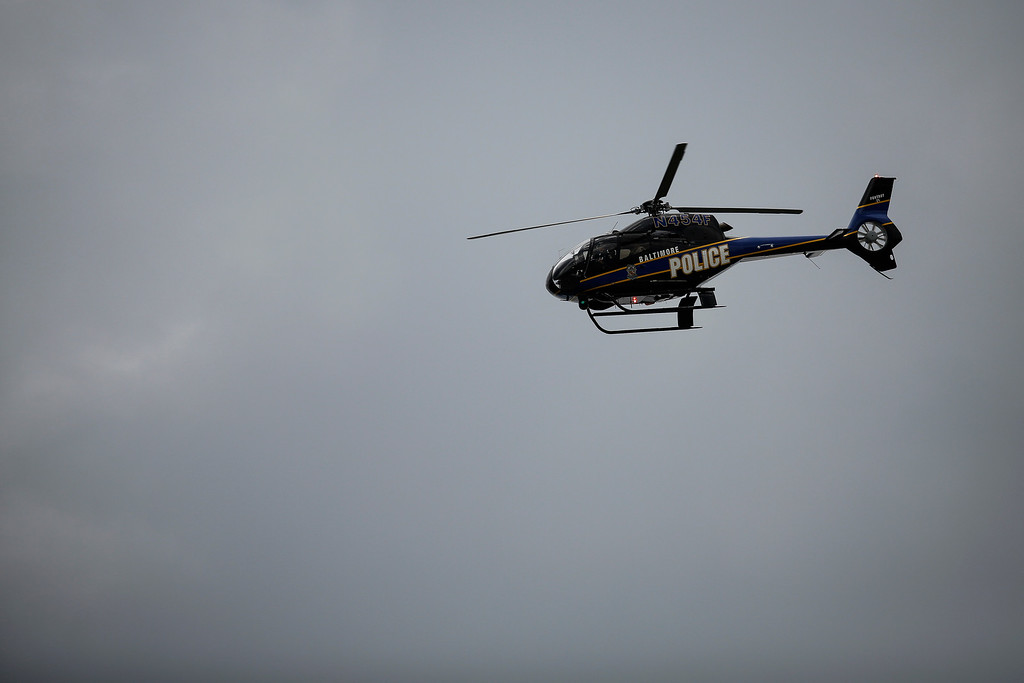 . BALTIMORE, MD - APRIL 27:   A Baltimore Police helicopter flies overhead near Mondawmin Mall, April 27, 2015 in Baltimore, Maryland. A group of young protestors clashed with police in the streets near Mondawmin Mall in the afternoon following Freddie Gray\'s funeral. (Drew Angerer/Getty Images)