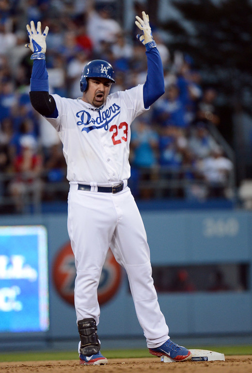 . Los Angeles Dodgers\' Adrian Gonzalez celebrates his a double in the fourth during game 4 of the NLCS at Dodger Stadium against the St. Louis Cardinals Tuesday, October 15, 2013. (Photo by David Crane/Los Angeles Daily News)