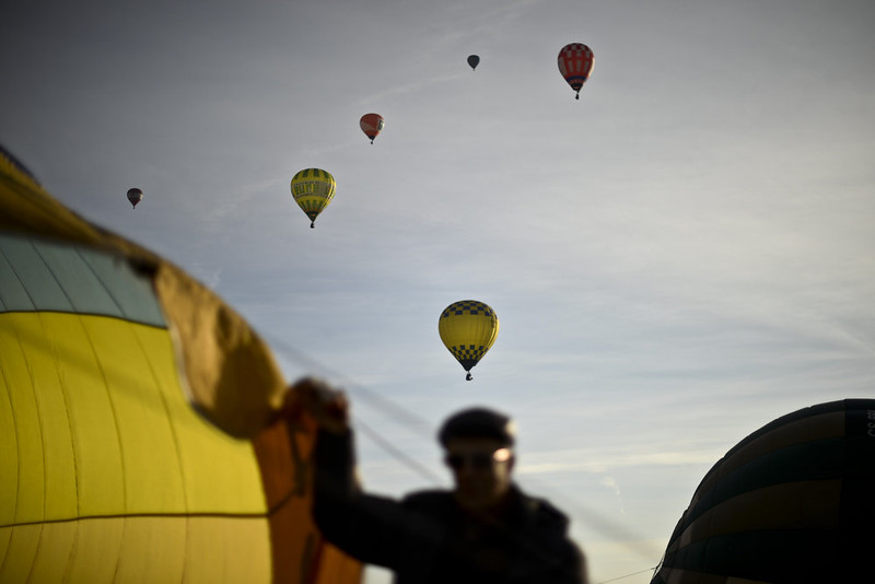 . A balloonist prepares his balloon while others fly during the 18th International Festival of Hot Air Balloons in Alter do Chao in the center of Portugal on November 10 2014. PATRICIA DE MELO MOREIRA/AFP/Getty Images