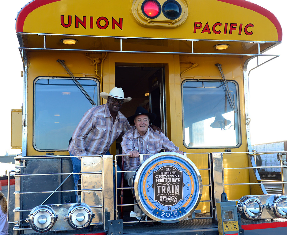 . DENVER, CO - JULY 18: Greg Moore, editor of The Denver Post, left, and William Dean Singleton, the paper\'s chairman, board the train bound for Cheyenne.  The Denver Post Cheyenne Frontier Days Train makes its 24th journey north to the Wyoming rodeo event. More than 500 passengers will ride this year\'s train of vintage cars pulled by the Union Pacific Railroad\'s 1950\'s era E-9 diesel streamliner. (Photo by Kathryn Scott Osler/The Denver Post)