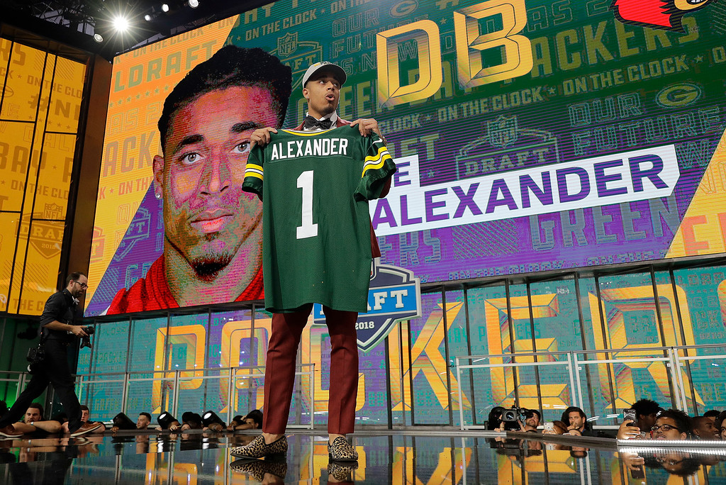 . Louisville\'s Jaire Alexander poses with his Green Bay Packers jersey during the first round of the NFL football draft, Thursday, April 26, 2018, in Arlington, Texas. (AP Photo/David J. Phillip)