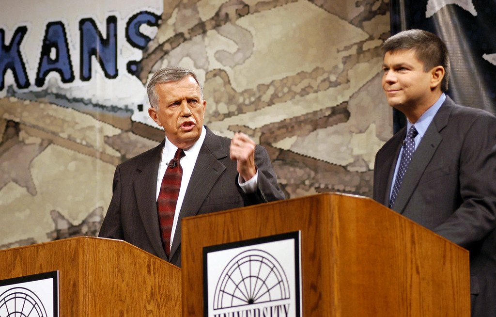 . FILE - In this Oct. 13, 2002, file photo taken in Conway, Ark., former Republican congressman Jay Dickey, left, debates the man who had replaced him two years earlier, Democrat Mike Ross. A funeral home confirmed Friday, April 21, 2017 that Dickey, who served four terms from southern Arkansas, had died but did not provide details, including the date. He was 77. (AP Photo/Spencer Tirey, File)