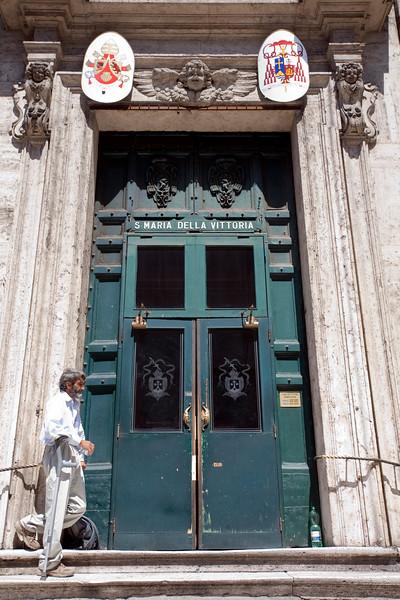 Entrance door of Santa Maria della Vittoria church, Rome