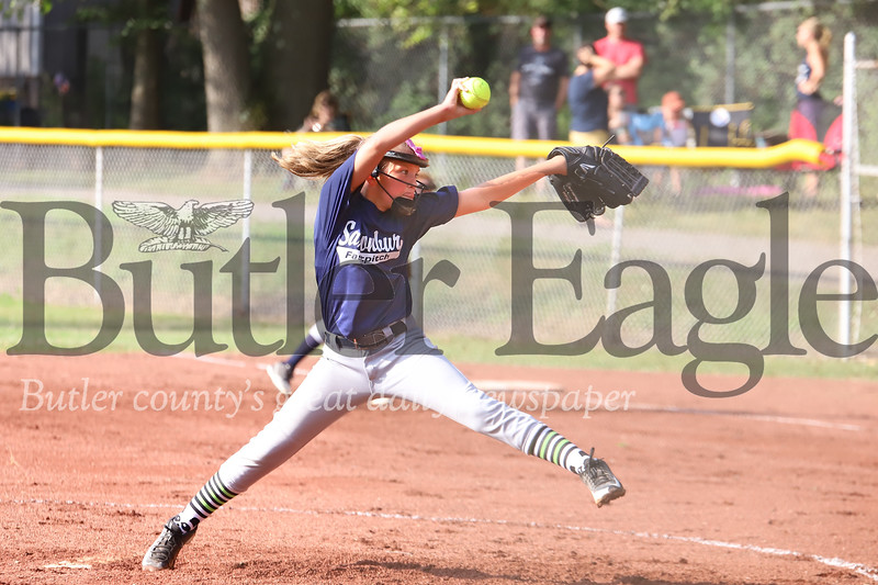 Kaila Purcell winds up to pitch in a hotly contested Saxonburg vs. Saxonburg 10-and-under softball game Tuesday evening at Laura J. Doerr Memorial Park. 07/21/20 Seb Foltz/Butler Eagle