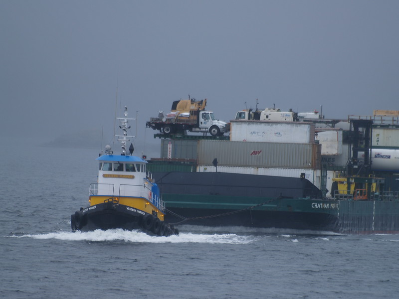 Supply tug with barge