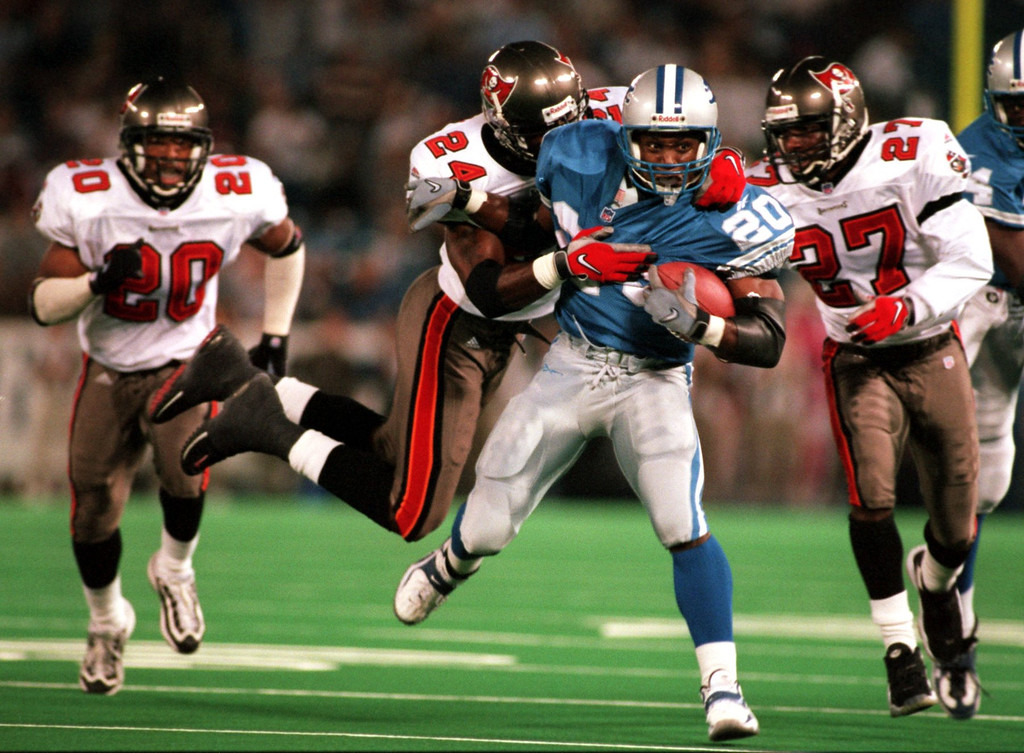 . Barry Sanders drags Tampa Bay defenders with him on his way to a big gain.