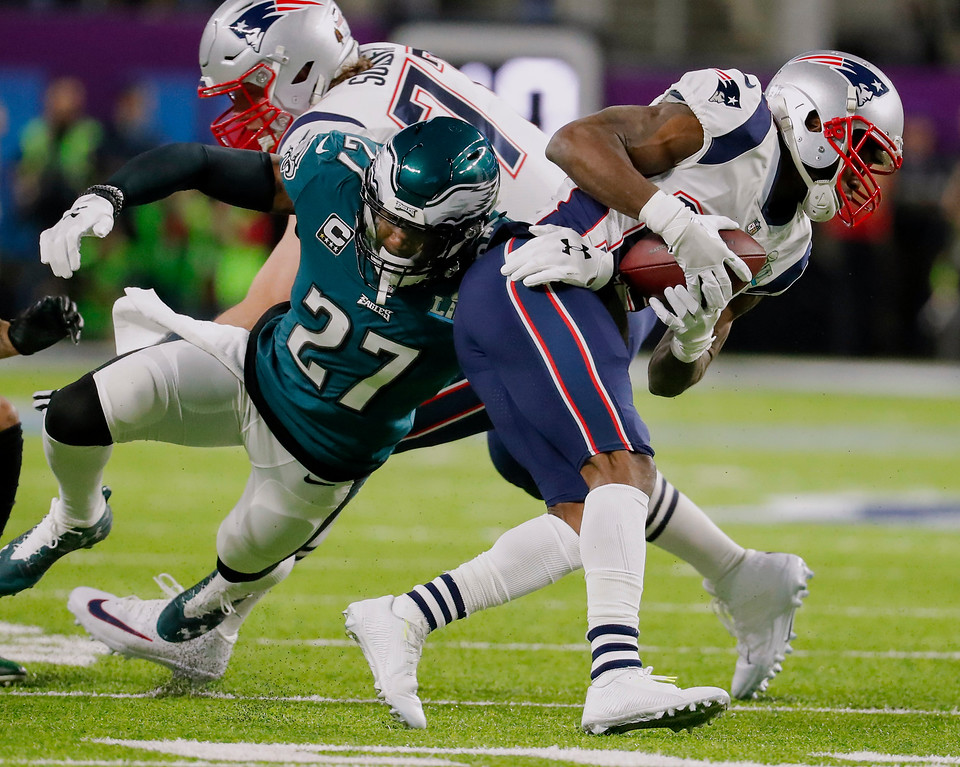 . Philadelphia Eagles strong safety Malcolm Jenkins (27), tackles New England Patriots wide receiver Brandin Cooks (14), during the first half of the NFL Super Bowl 52 football game, Sunday, Feb. 4, 2018, in Minneapolis. (AP Photo/Charlie Neibergall)