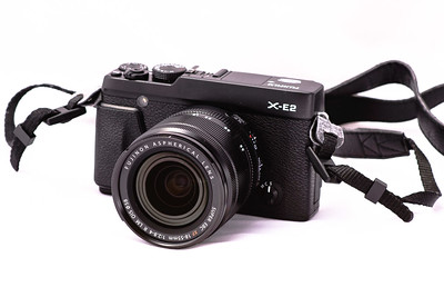 Fuji X-E2 18-55/2.8-4 OIS lens + Fuji EF-42 TTL flash