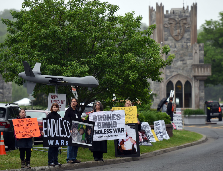 . Protesters gather outside the Thayer Gate at the United States Military Academy on May 28, 2014 in West Point, New York. President Obama is scheduled to deliver the 2014 commencement address at the US Military Academy.  (DON EMMERT/AFP/Getty Images)